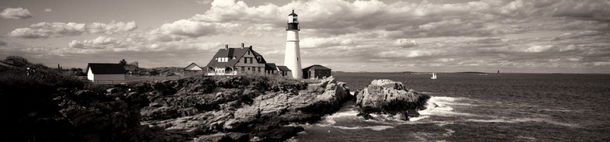 Image: Black-and-white image of a lighthouse on rocks